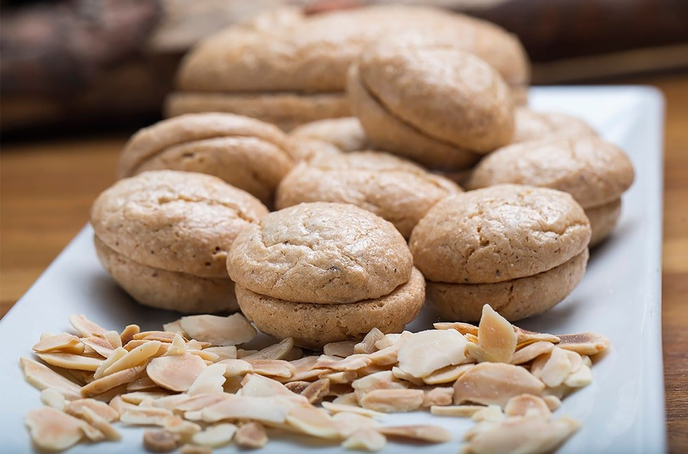 A platter of bitter almond cookie with nuts and macarons.