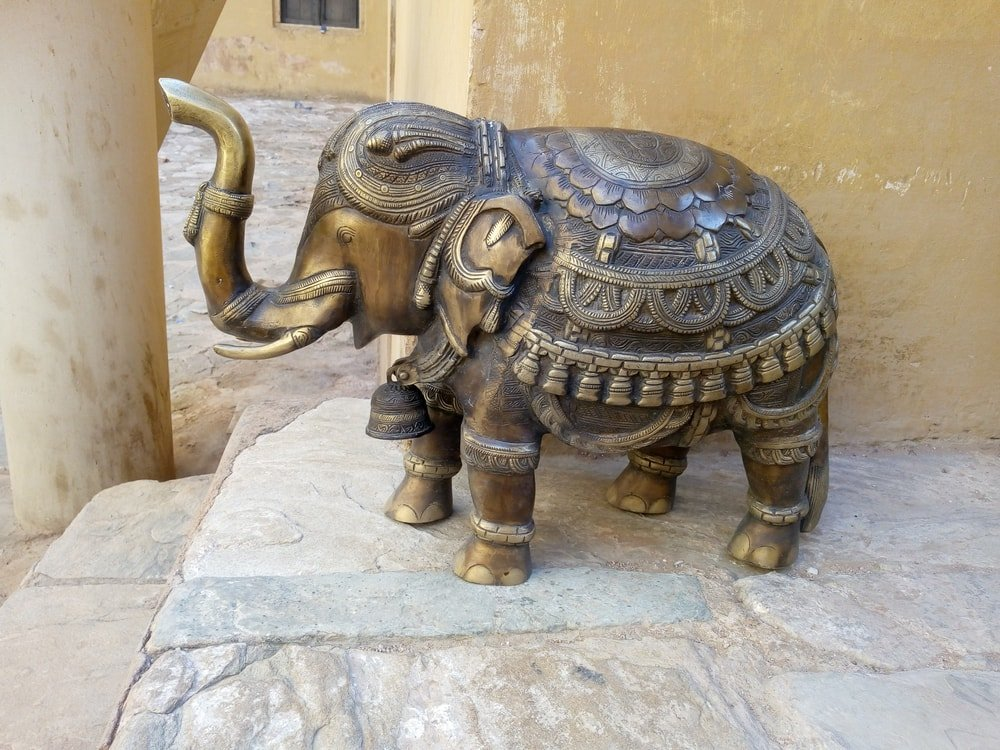 This is an antique handcrafted copper elephant statue.