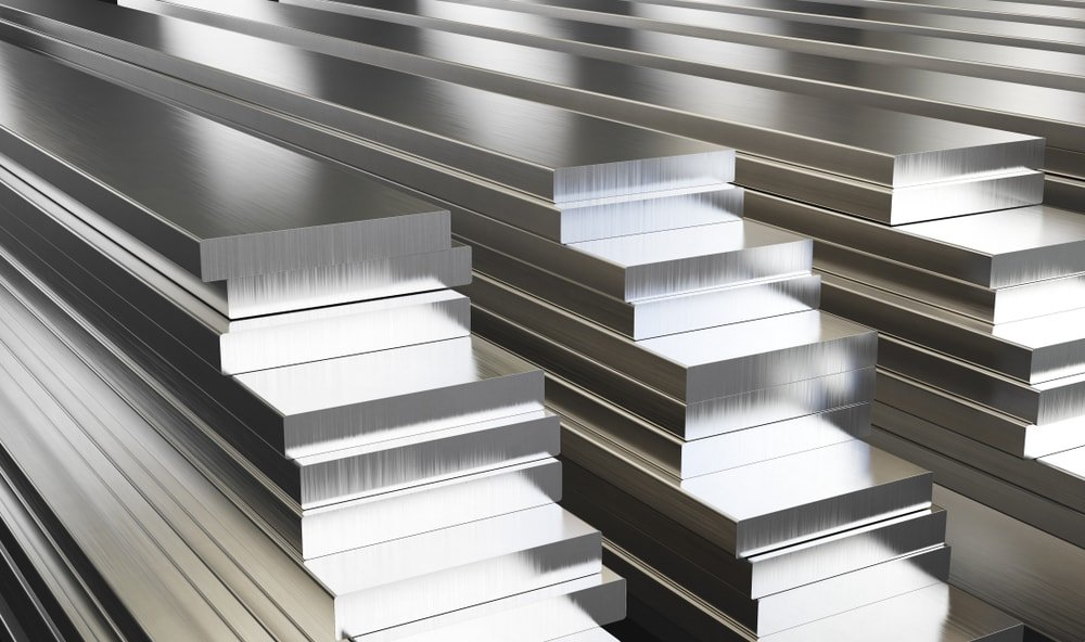 Large pieces of aluminum stacked and on display at a store.