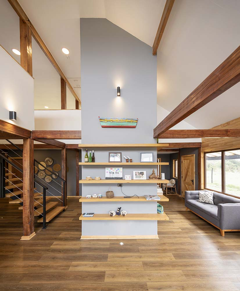 Across from the kitchen is this large pillar with built-in floating shelves by the staircase.