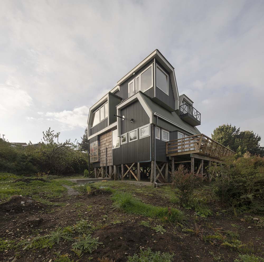 This angle of the house showcases the glass windows of the house with various sizes.