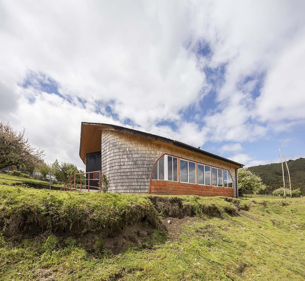 This side of the house showcases the landscape surrounding the simple design of the house.