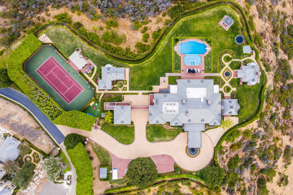 This is an aerial view of the whole property showcasing the various structures, large driveways lush landscaping. Image courtesy of Toptenrealestatedeals.com.