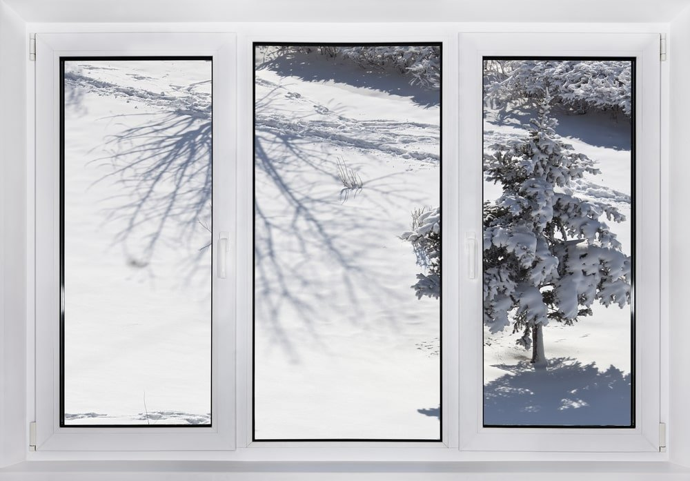 A set of windows with a winter scenery.