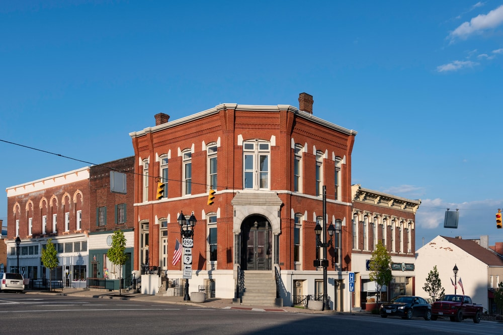 This is an old Harrison National Bank building with an Italianate architectural design.