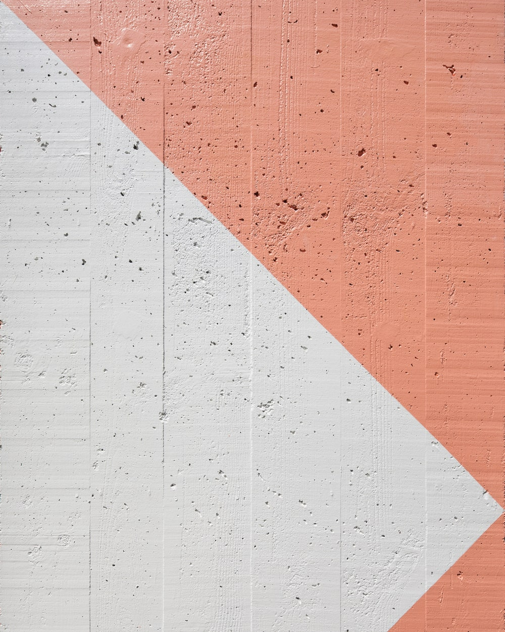 This is a close look at the colorful and patterned concrete chimney structure on the side.