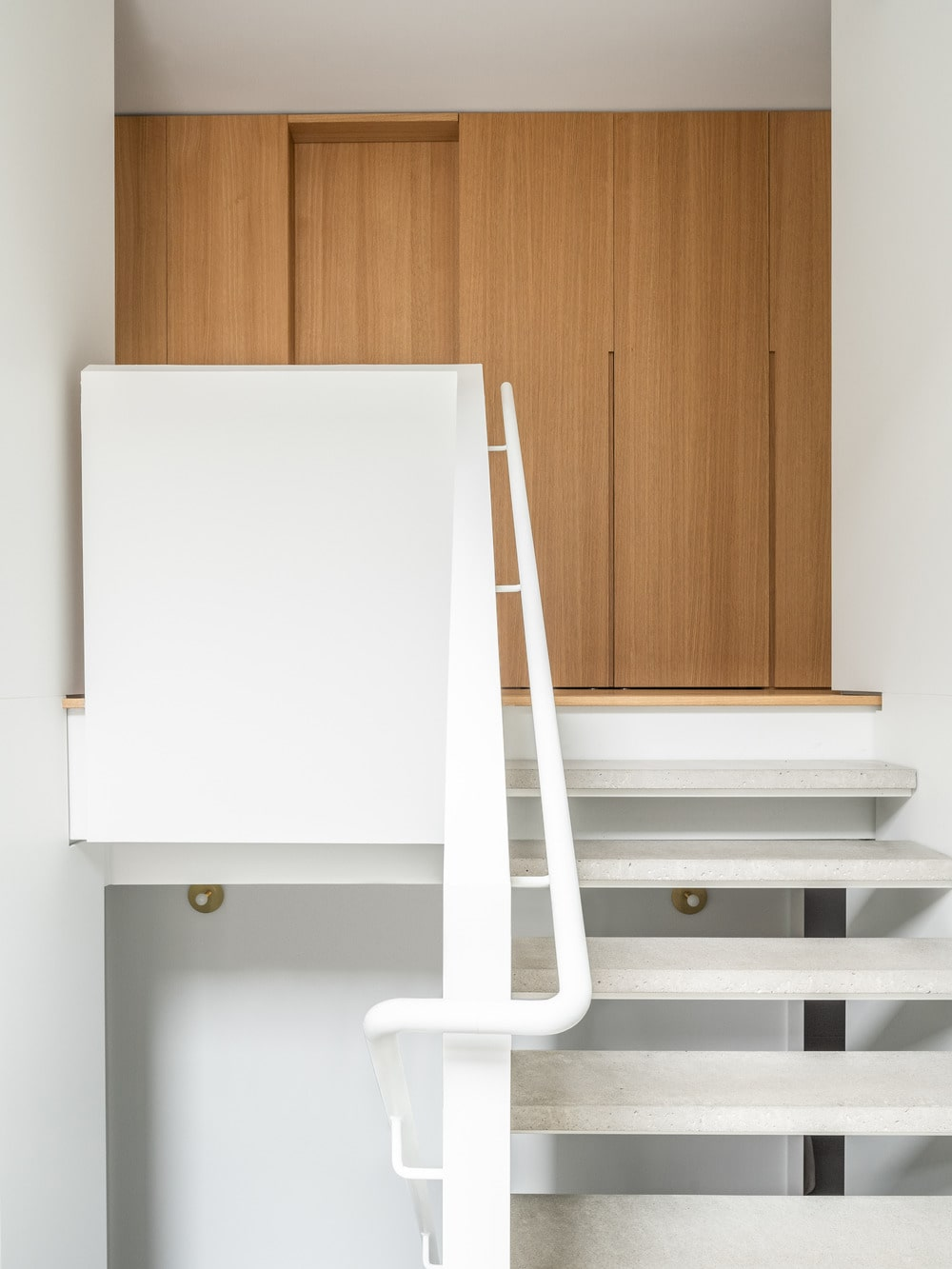 The steps of the stairs are supported by the banisters and walls on its sides.