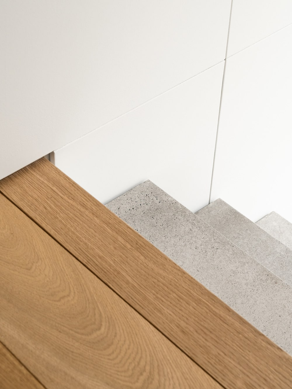 This is a look down the stairs from the vantage of the landing that has a hardwood flooring.