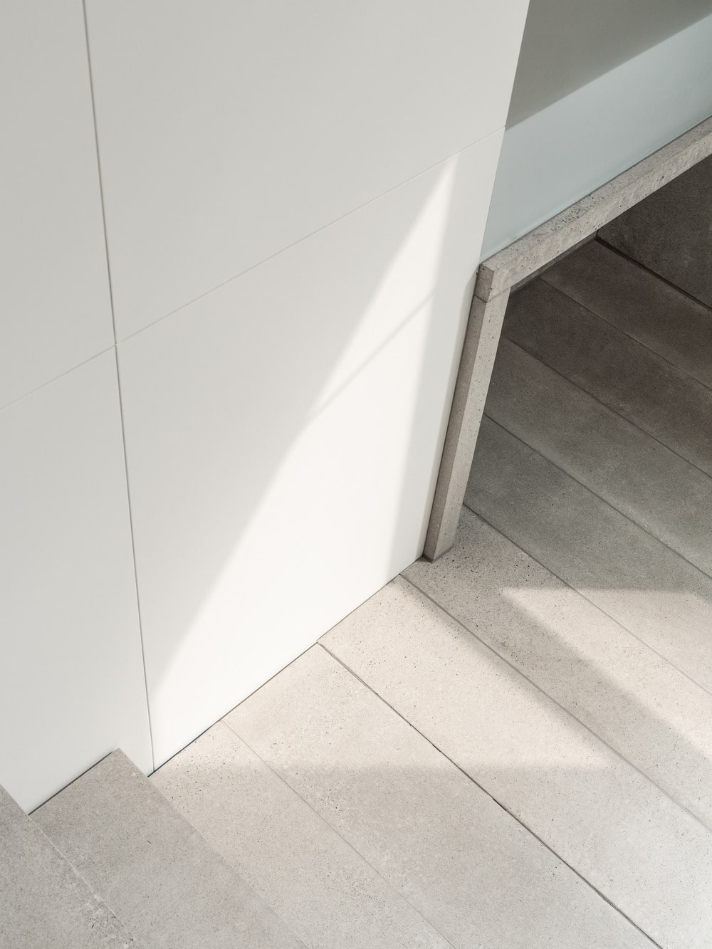 This provides a small alcove at the foot of the stairs that provide an area for shoe storage.