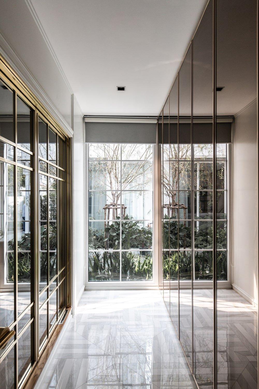 This is an interior view of the house showcasing a hallway filled with glass on both sides.