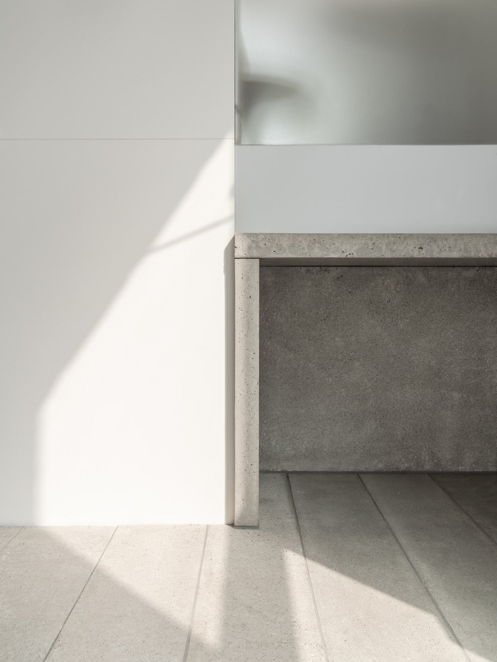 On the side of the foyer is the built-in concrete console table topped with a mirror.