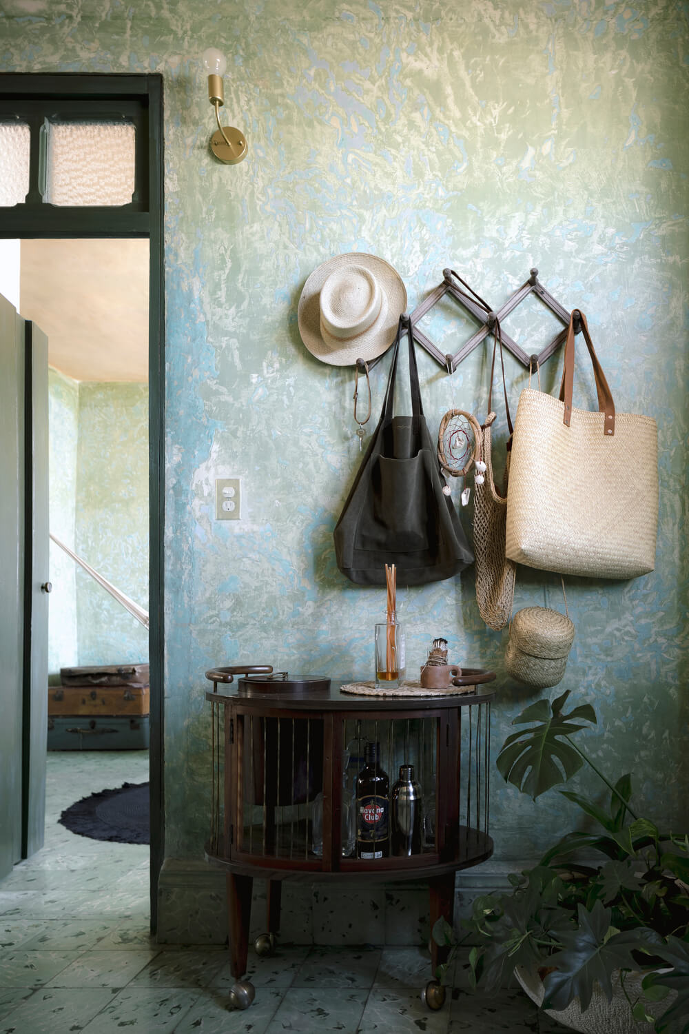 Upon entry of the house, you are welcomed by this simple foyer with a credenza waist-high cabinet topped with a set of hooks for bags and hats.