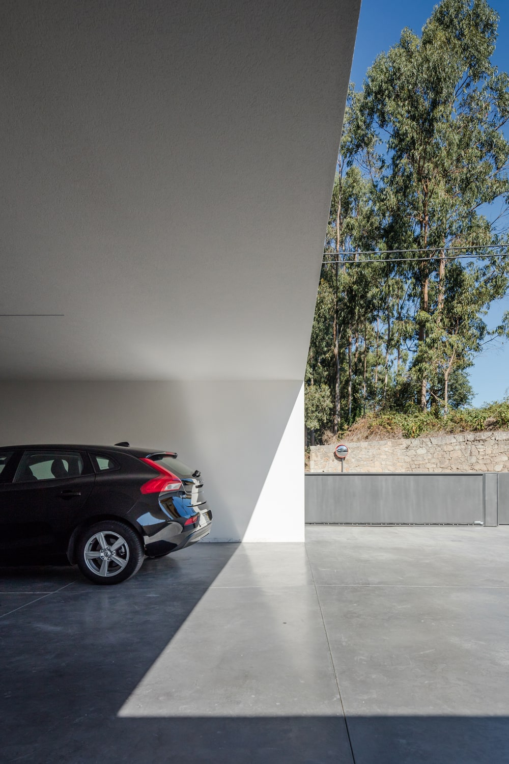 This is a close look at the car port of the house that can fit multiple cars.