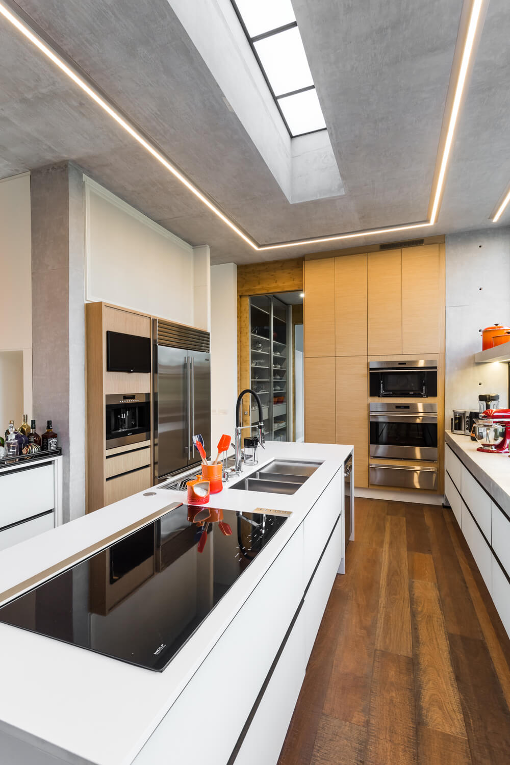 The natural light pairs well with the white kitchen island with modern cabinetry.