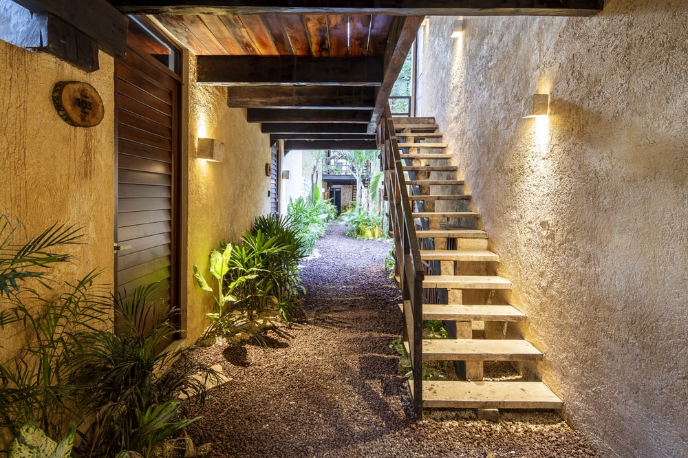 This is a look at a hallway just outside the house with a staircase access to the upper floors from the garden.