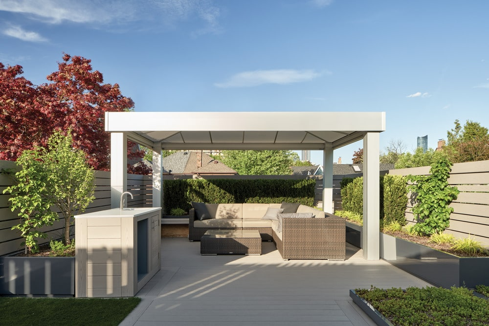 This is a patio area under a large gazebo within the property.