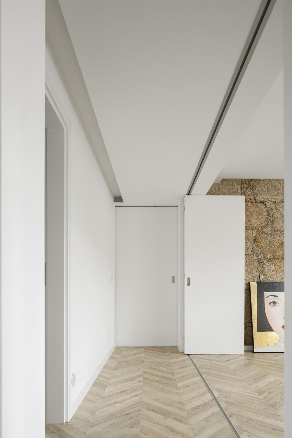 This is another look at the folding white doors and how it blends with the white ceiling.
