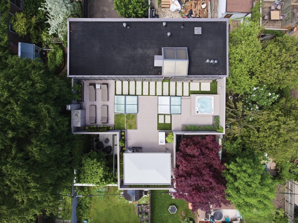This is an aerial view of the house exterior featuring the outdoor areas of the house.