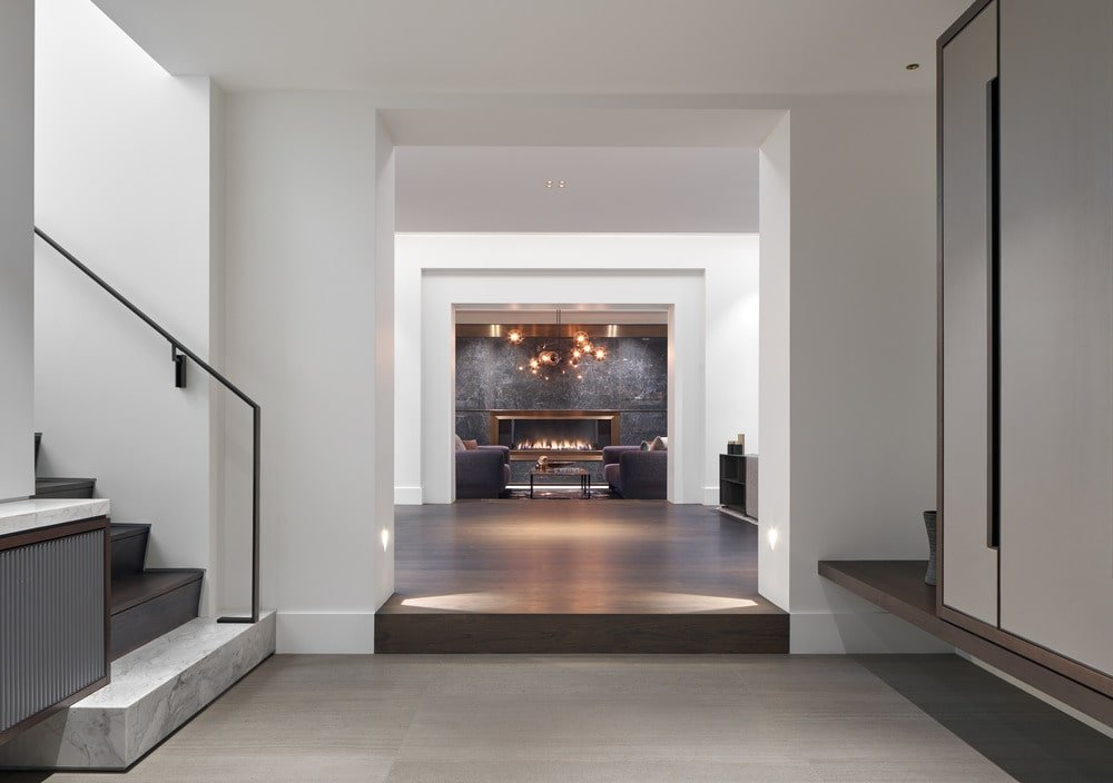 The staircase is only a few steps across from the mudroom of the foyer.