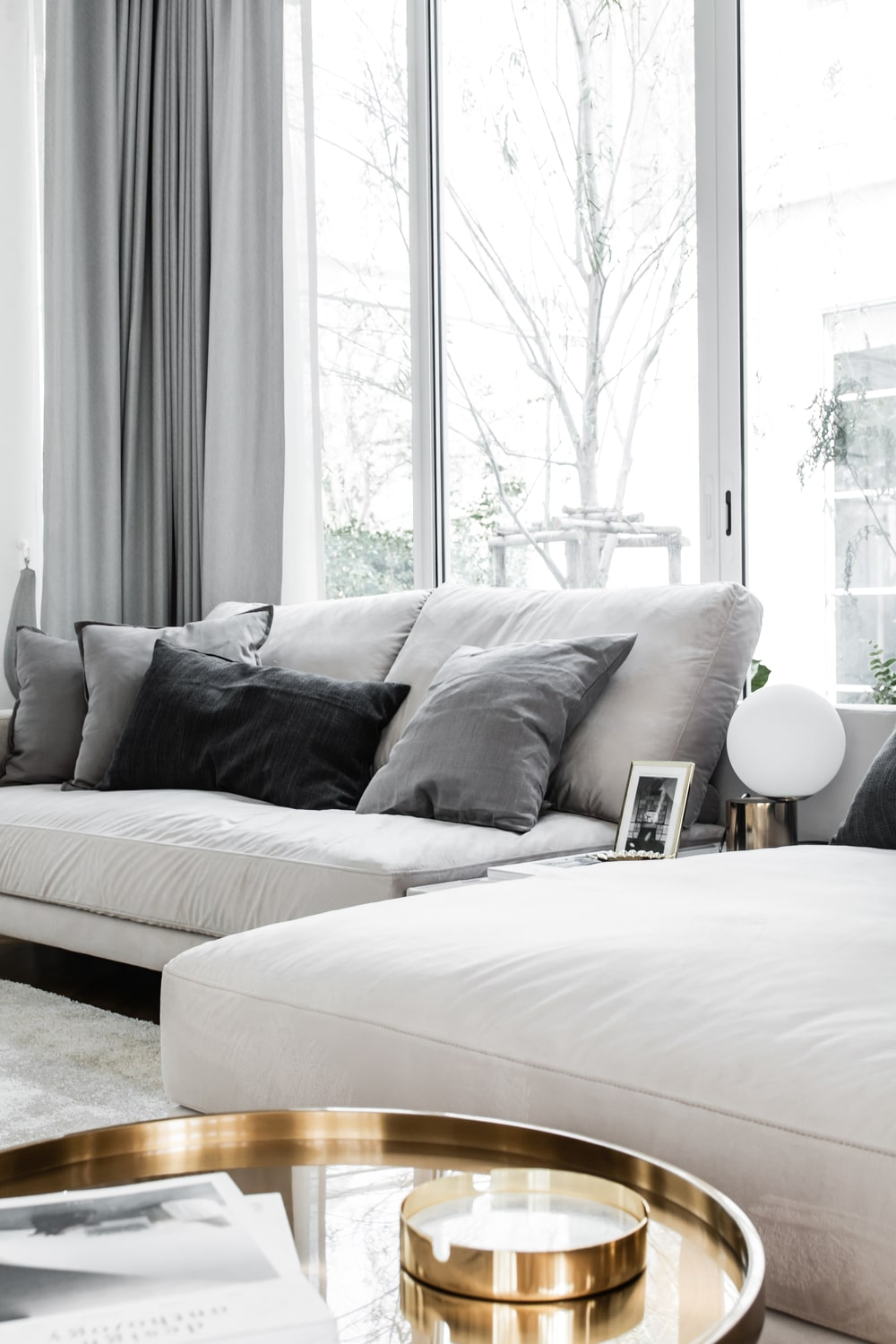 The coffee table is surrounded by light beige sofas.