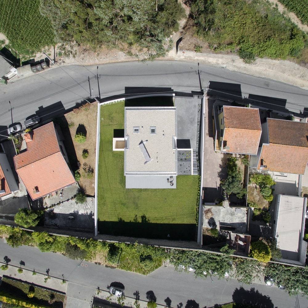 The aerial view of the house shows the property line and the road access of the house.