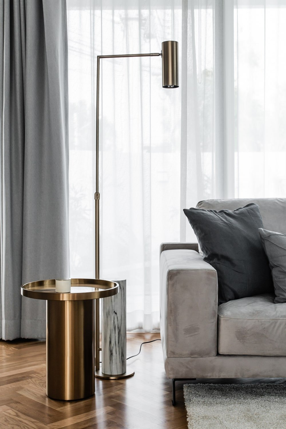 This is a close look at the end table of one of the sofas with a golden metallic tone to it.