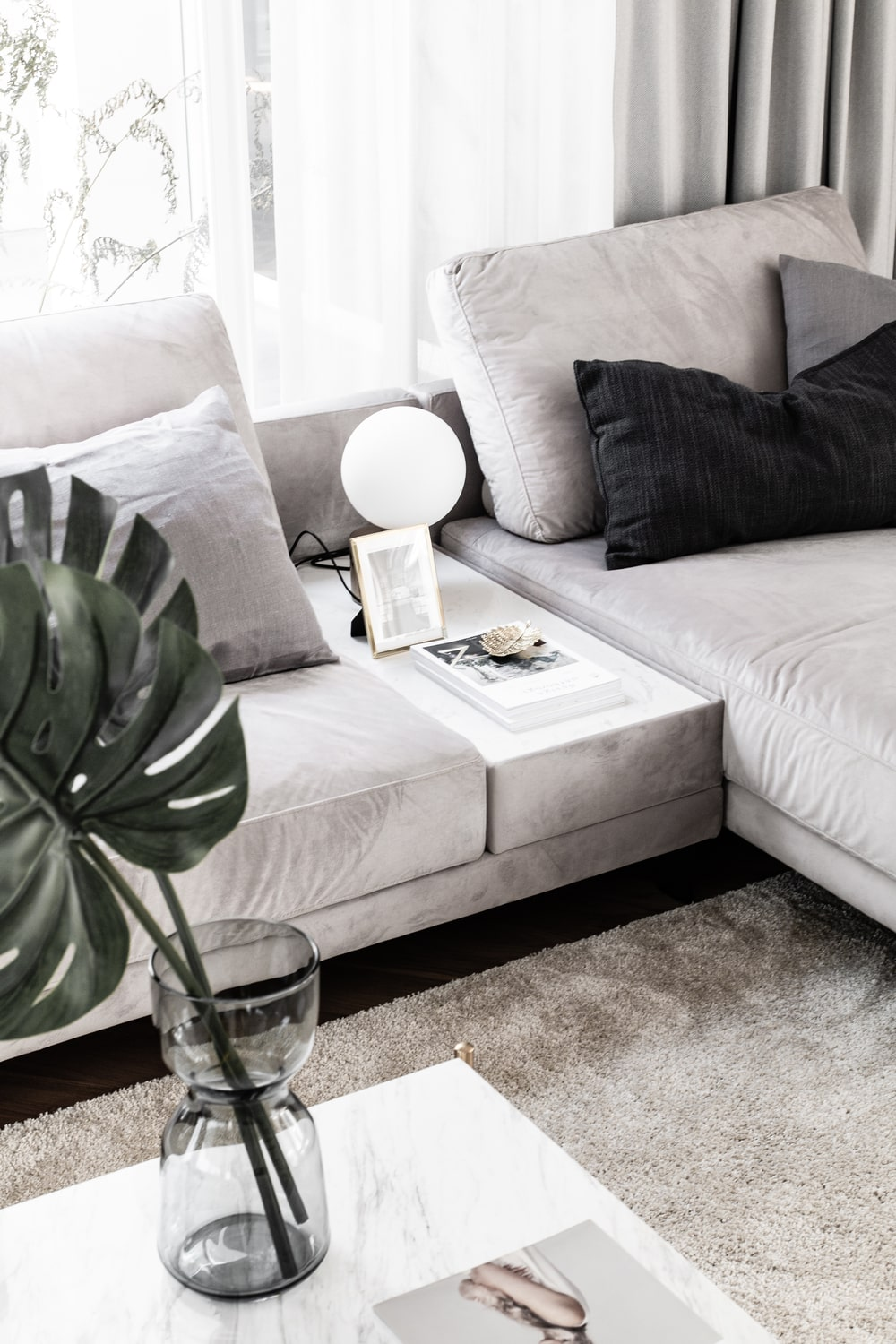 This is a close look at the divider of the L-shaped sofa that also serves as a table surface.