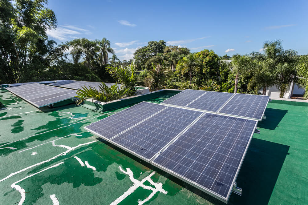 The rooftop has multiple solar panels facing the sun at an angle.
