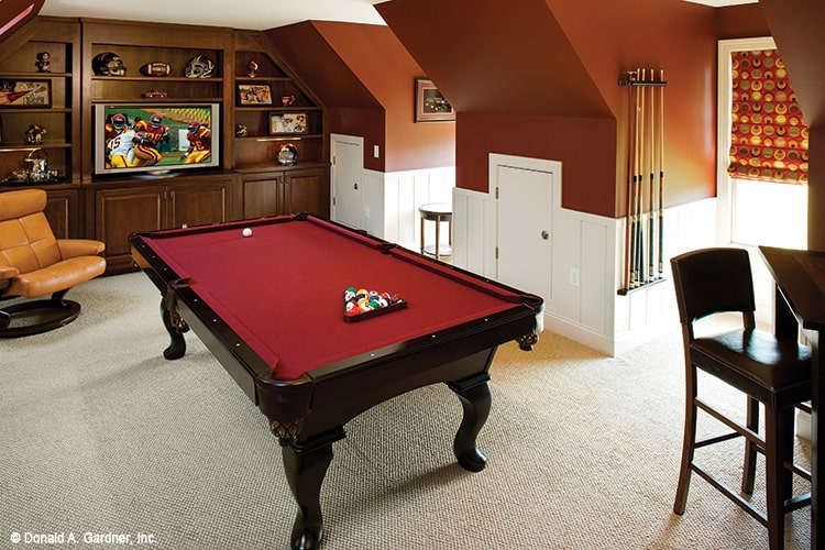The game room offers multiple sitting areas, a TV, and a billiards table.
