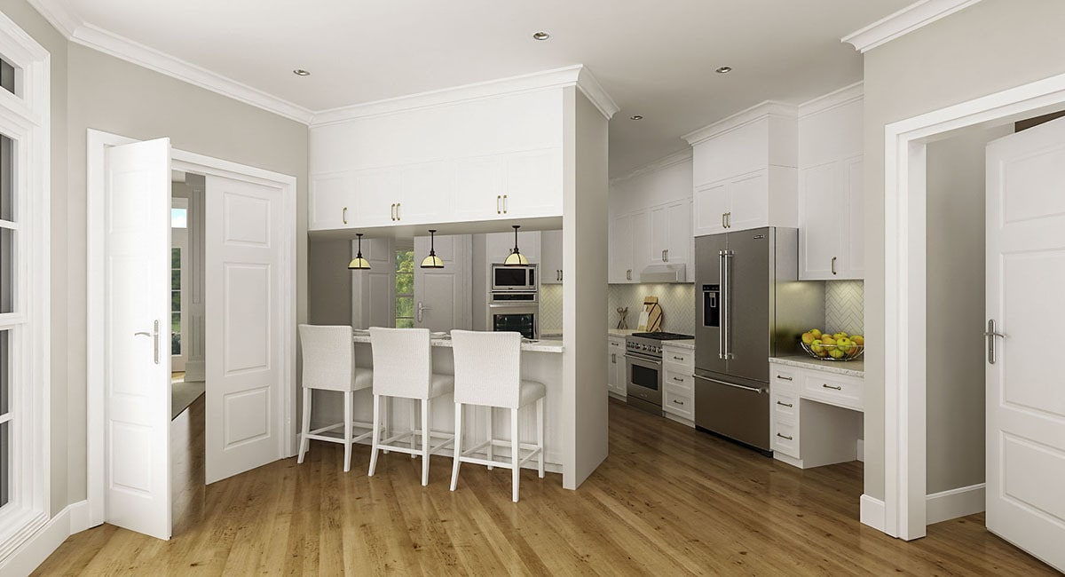 Kitchen with white cabinetry, stainless steel appliances, and an angled peninsula.
