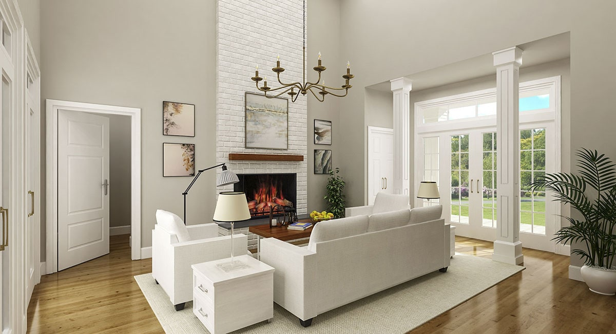 The living room has light gray seats and a fireplace fitted on the white brick accent wall.