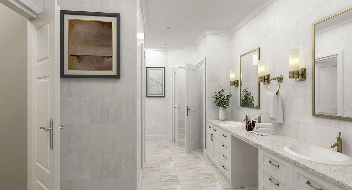 The primary bathroom features a dual sink vanity with a marble countertop and brass-framed mirrors.