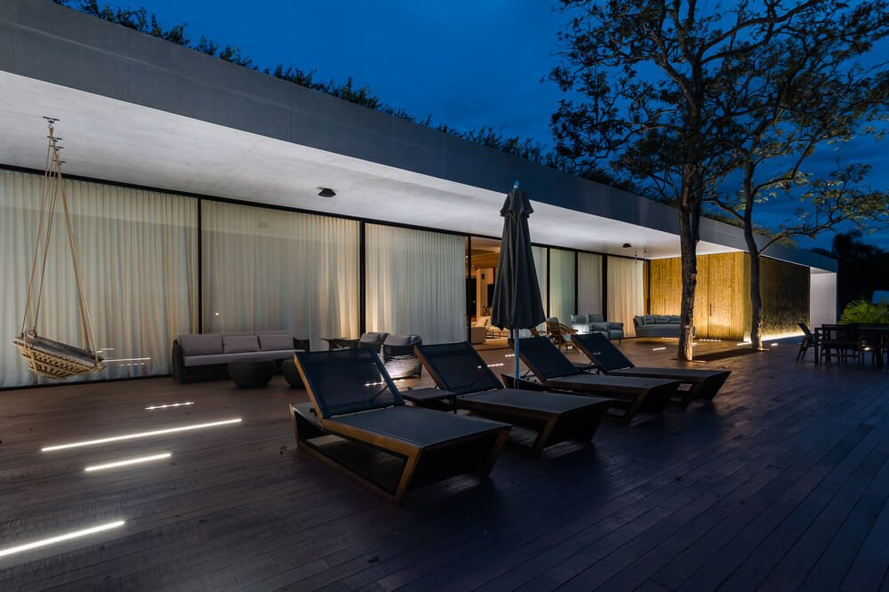 These lounge chairs pair well with the wooden deck flooring of the area.