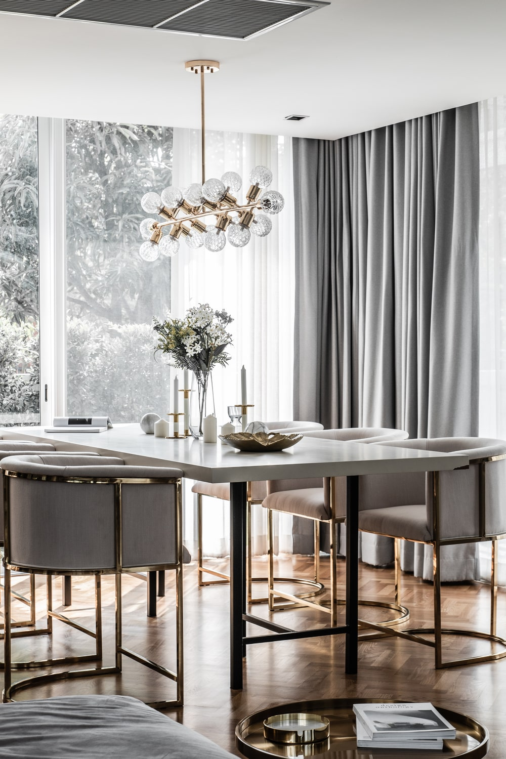 This is a close look at the dining area with a white dining set brightened by the natural light coming in from the large window.