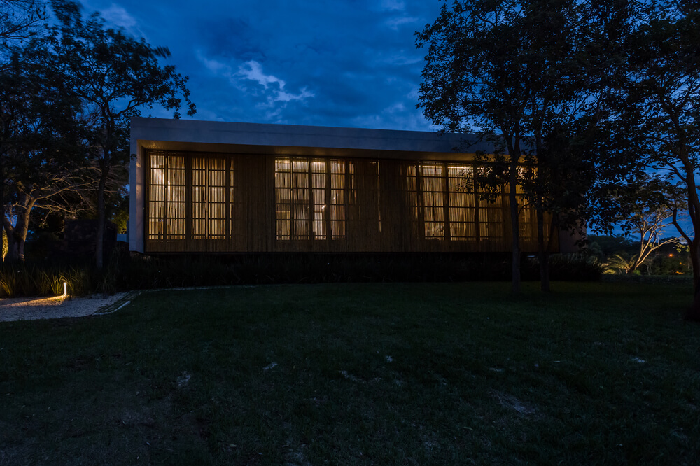 This side of the house has bamboo panels on its walls that also allow light to escape giving it a unique look.