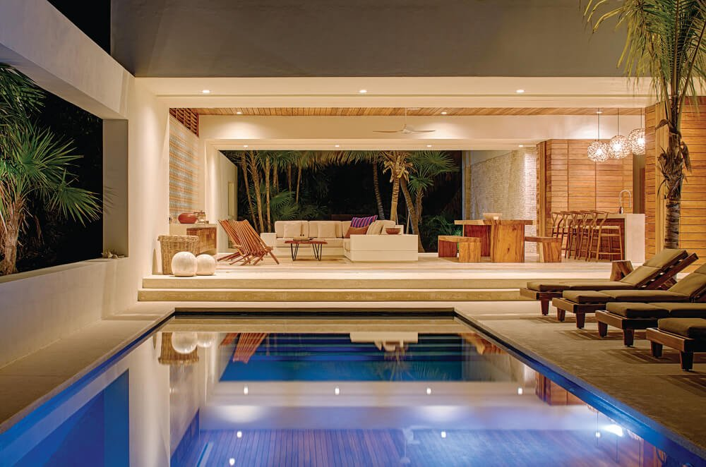 A few steps from the living room is the poolside area that has lounge chairs facing the pool.