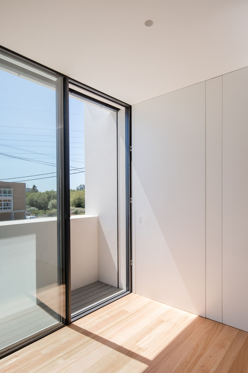 This is a corner of the upper level with a set of sliding glass doors leading to a balcony.