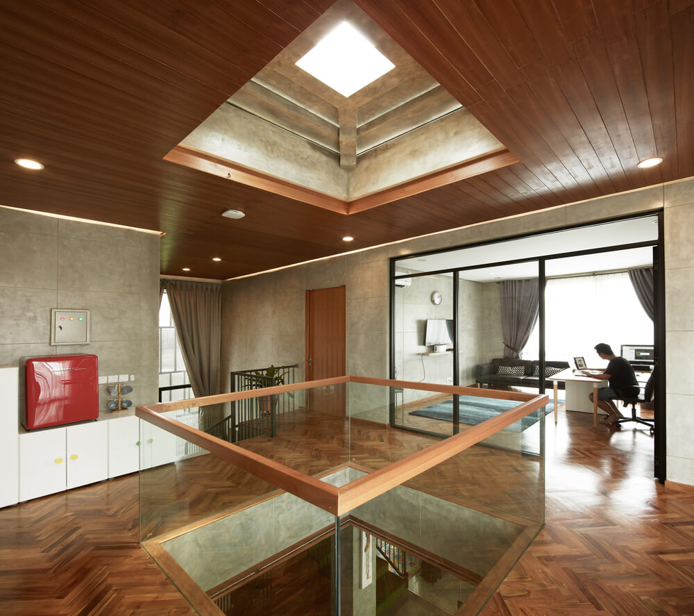 This is the indoor balcony over the living room with a skylight above and glass railings.