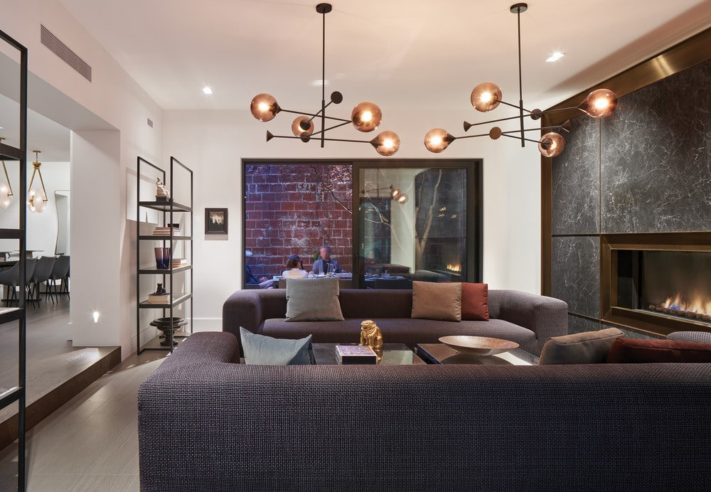This other showcases more of the twin sofas flanking a glass-top coffee table.