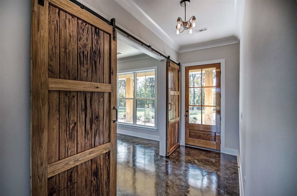 The foyer has a glass chandelier and barn sliding doors to its left leads to the formal dining room.The foyer has a glass chandelier and barn sliding doors to its left leads to the formal dining room.