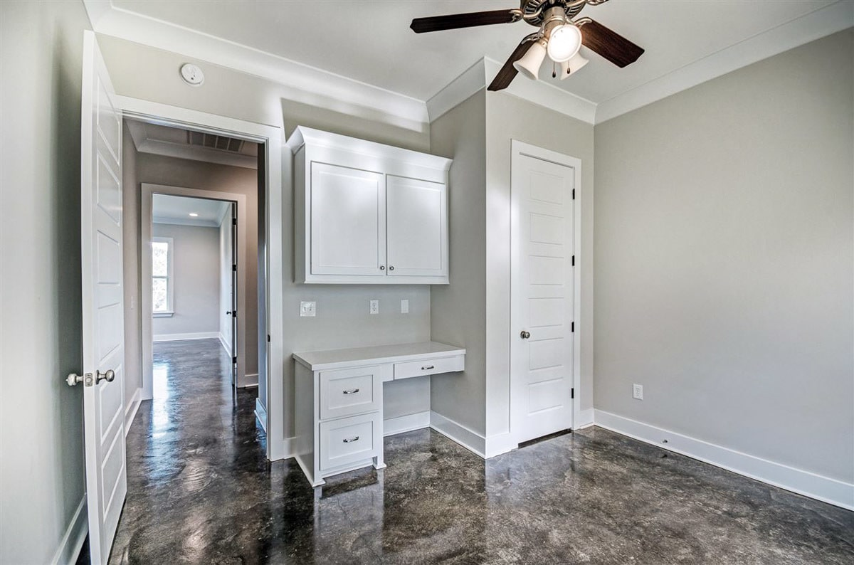 The bedroom includes a built-in desk and walk-in closet.