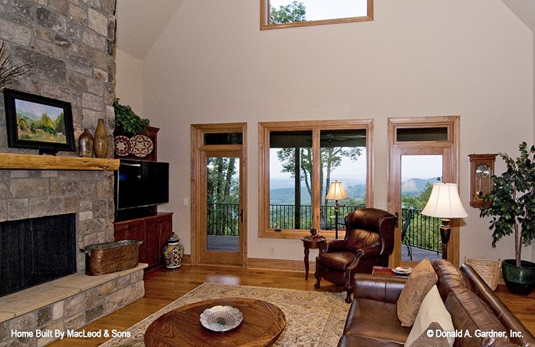 Two glass doors at the rear wall lead to a covered porch.