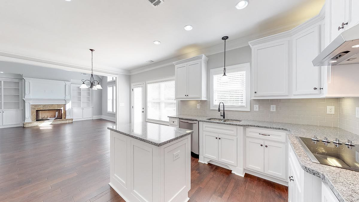 An open layout view showing the gourmet kitchen and the spacious living area.