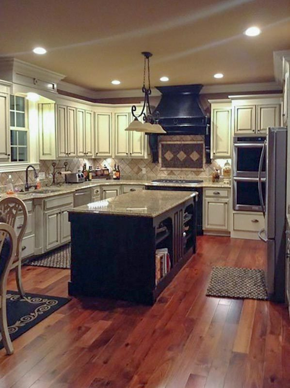 There's also a large island paired with a wrought iron pendant light.