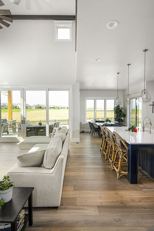 An open concept layout showing the living room, kitchen, and dining area.