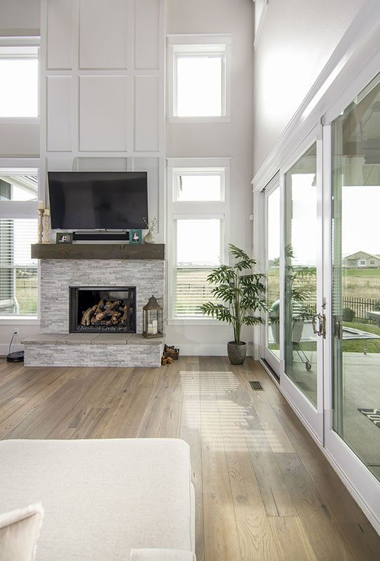 A stone fireplace with a TV on top completes the living room.
