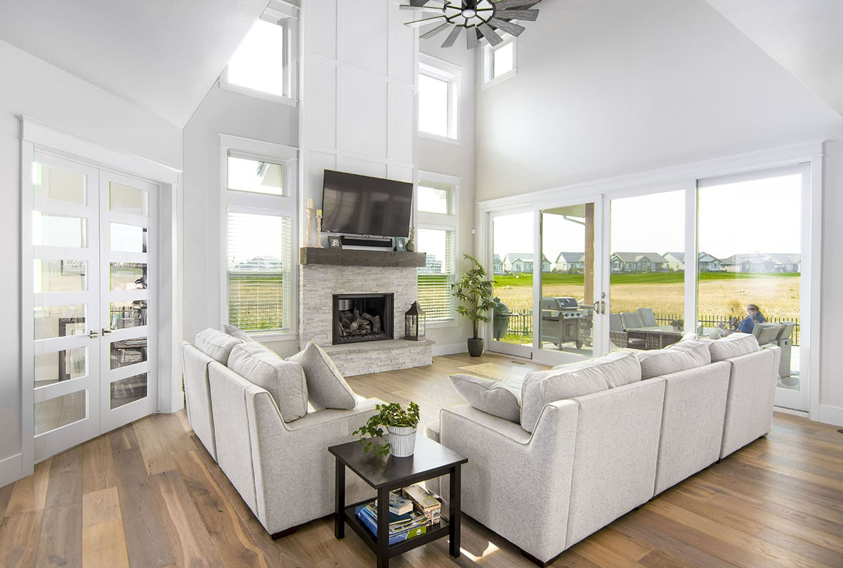 The living room is bright and airy with its clerestory windows, oversized sliding glass doors, and a high vaulted ceiling.