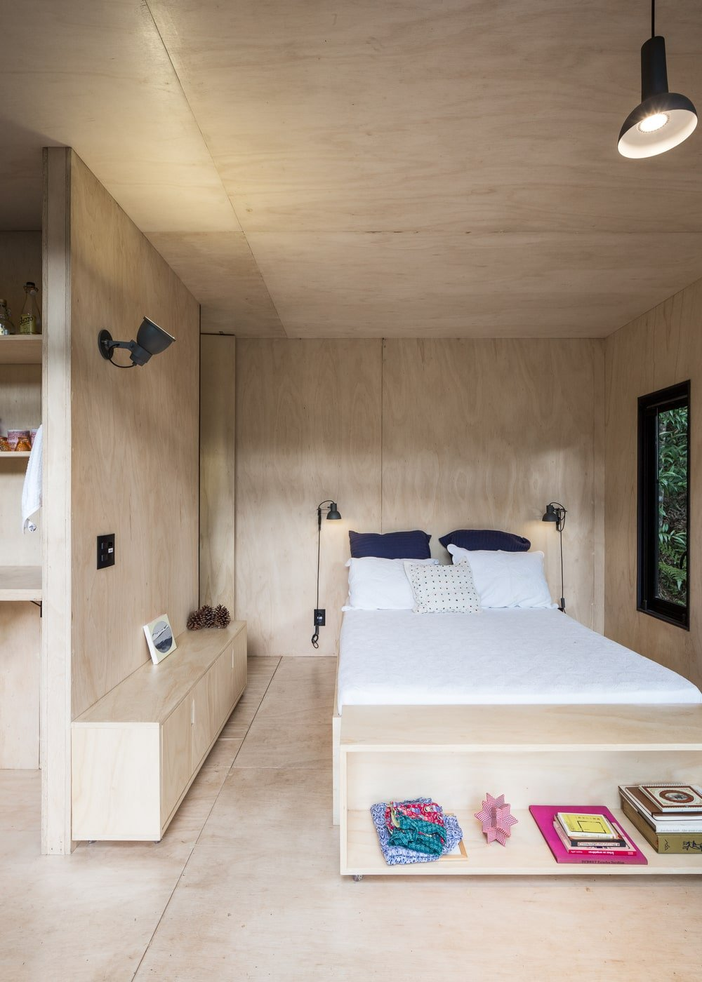 This is a closer look at the bedroom area that has built-in wooden structures and an alcove-like nook at the corner of the interior.