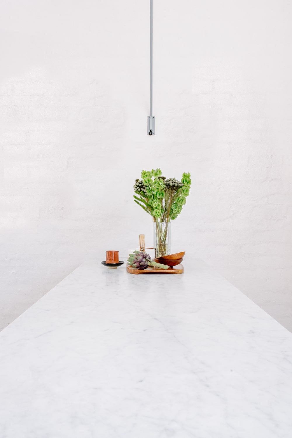 This is the countertop of the kitchen island with a white marble tone.