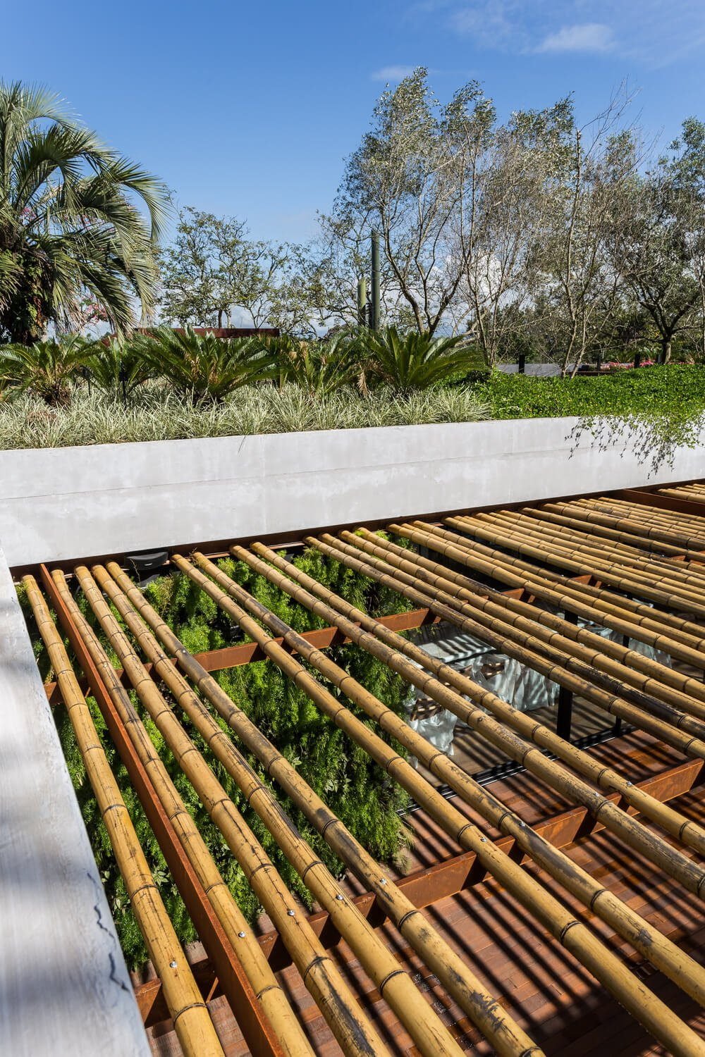The wooden trellises over the deck patio is made of pieces of bamboo.